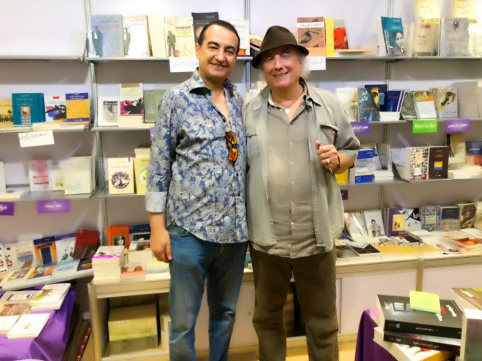 Mohamed Dekkak receives book dedication from Waciny Laredj on the event Abu Dhabi International Book Fair 