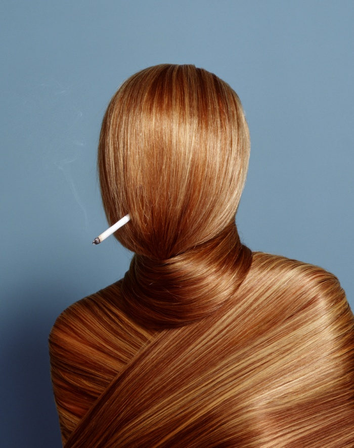 This image was for a story on investment growth, for Bloomberg Wealth Manager Magazine.  There is a live model underneath all that hair, having endured 7.5 hours of hair extension application, hairspray and without one potty break.  Needless to say, there was no lighting the cigarette in her mouth, and the smoke was later added in post.