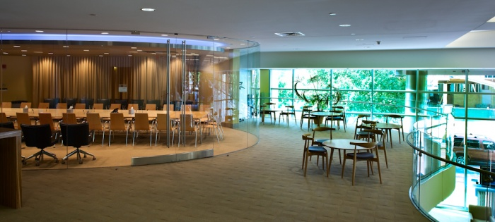 Circular glass walled conference room and adjacent lounge area. Tenant is a medical Bio-Lab research facility.