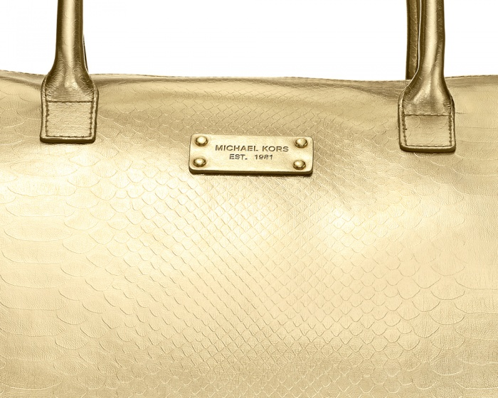 This was a retouch for the brand Micheal Kors, a limited edition gold weekender bag. Please visit my full site to see the full bag retouch.