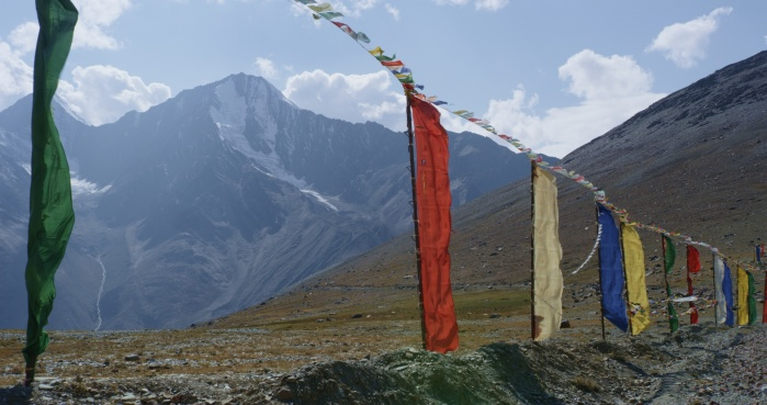 Prayer flags line the access road to the temple at Konjom  Pass in the Himalayas.