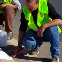 The volunteers of Anouar Association start applying new paints to the roundabouts as part of its Lan